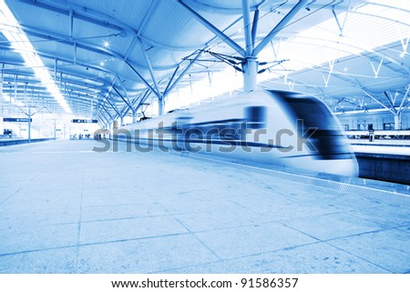 High speed train fast passing station with motion blur.