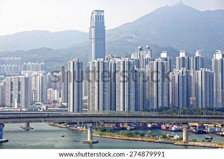 high speed train on bridge in hong kong downtown city at day - stock photo