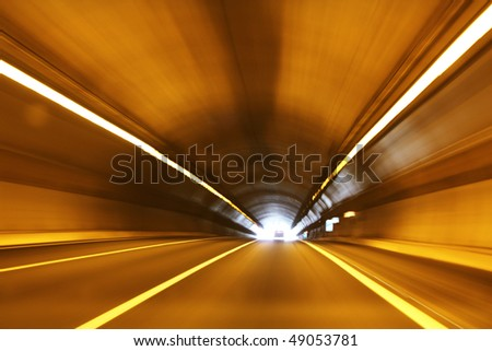 High speed tunnel. Exiting a tunnel at high speed. - stock photo