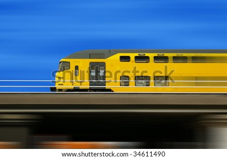 High speed yellow train on a blurred background - stock photo
