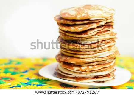 High stack of pancakes . Breakfast for the whole family . With copy space. Shallow DOF