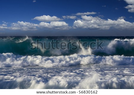 high strong ocean waves with spray and surf under blue cloudy summer sky pacific coast australia - stock photo