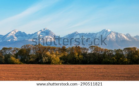 High Tatra mountains and farm field at the morning sunshine