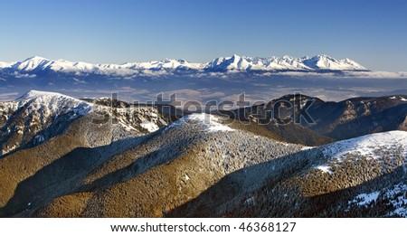 High Tatras from peak Chopok (Low Tatras) in winter. - stock photo