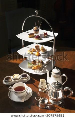 High tea set with dessert,Afternoon tea set - stock photo