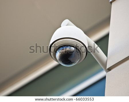 High tech overhead security camera at a government owned building. - stock photo