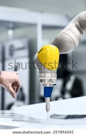 High technology robotic arm closeup photo in factory - stock photo
