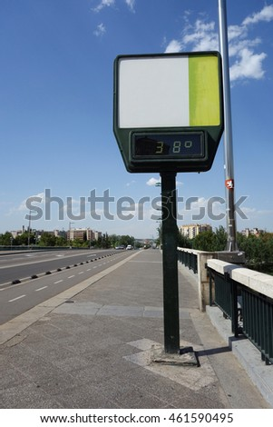 high temperature on the bridge. A thermometer with no advertisement showing 38 degrees