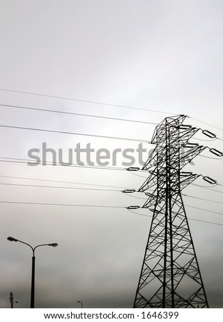 High tension electric pole and wires - stock photo