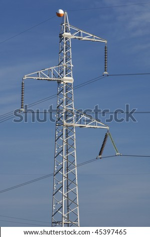 High tension electrical tower with blue sky