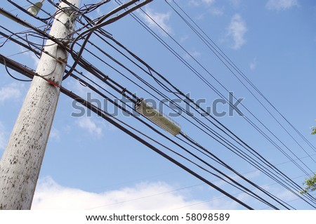 high tension hydro power electricity cable lines live wire overhead with sky background - stock photo