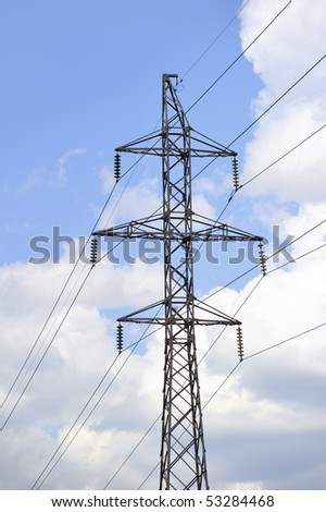 High-tension power line with clouds on background