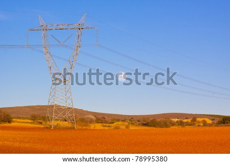 High tension  transmission lines crossing the colorful fields of Spain.