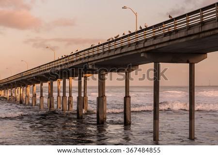 High tide at Ocean Beach fishing pier in San Diego, California.  - stock photo