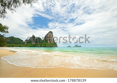 High tide during monsoon season in scenic Railey Bay, Krabi, Southern Thailand. - stock photo