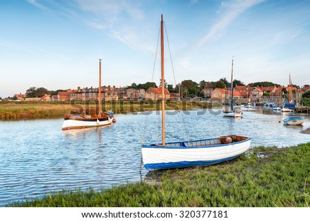 High tide on the salt marshes at Blakeney on the north coast of Norfolk - stock photo