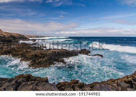 High Tide with Big Waves Crushing on the Rocks with Turquoise Water - Northern Coast of Tenerife, Canary Islands, Spain - stock photo