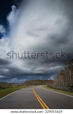 High top thunderheads warn of approaching rain - stock photo
