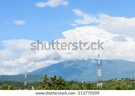 HIGH TOWER WITH ANTENNA FOR COMMUNICATION WITH   BLUE SKY AND CLOUD - stock photo