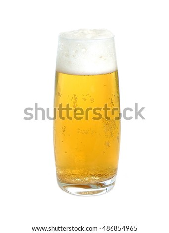 High transparent glass full of cold amber beer isolated on white background closeup. Vertical front view