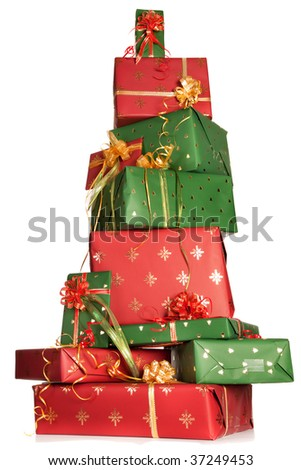 High up tower of red and green christmas presents - stock photo
