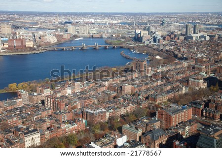 High view of Boston Brownstones and Charles River from the Observation Deck of the Prudential Tower.