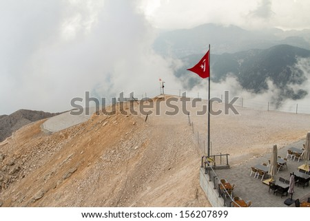 High view of landscape, foggy mountain and cloudy weather with wavy Turkey flag.