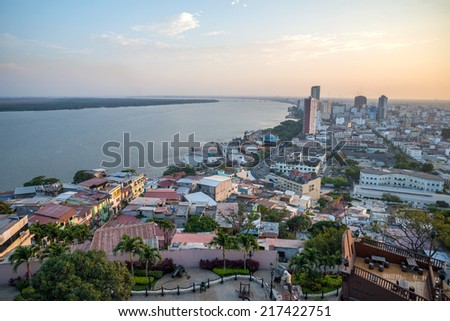 High view of the city of Guayaquil and it's river, at sunset - stock photo