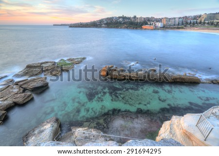 High views from the cliff top overlooking the northern rockpool at Coogee in Sydney's eastern suburbs.  Giles Baths is a natural rock pool, known as the Bogey hole - stock photo