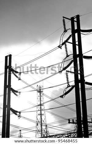 high voltage at sunset. - stock photo