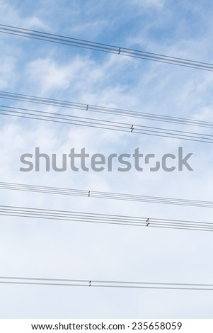 High voltage cable on the sky - stock photo