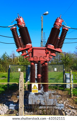 High voltage circuit breaker in a power substation - stock photo