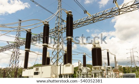 High voltage circuit breaker in a power substation in blue sky