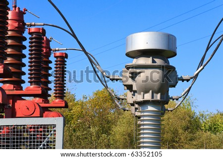 High voltage current transformer in a power substation - stock photo