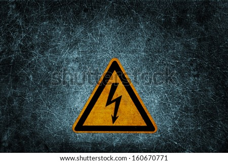 High voltage danger sign on dirty grunge wall background - stock photo