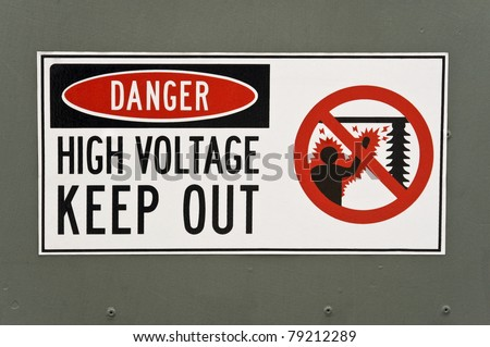 High Voltage Danger Sign Painted on the Metal Surface of a Transformer - stock photo