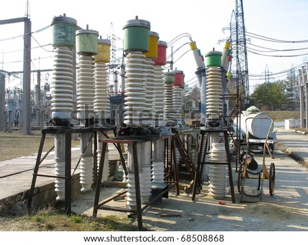 High voltage electric isolators detail at a power plant - stock photo