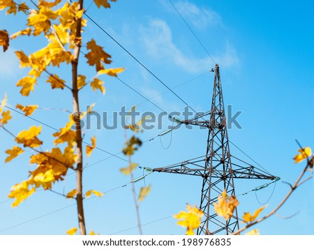 High voltage electric pillar with wires on a background of the autumn sky - stock photo