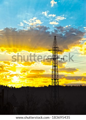 High voltage electric power line during sunset. - stock photo