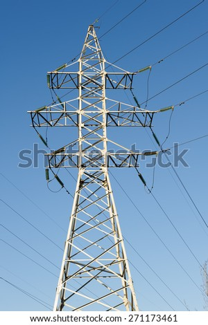 high voltage electric power lines on pylons - stock photo