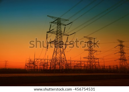 high voltage electric power steel tower in the setting sun, closeup of photo
