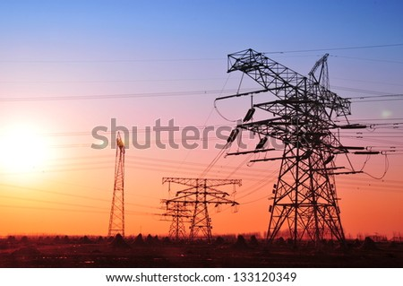 High voltage electric tower line - stock photo
