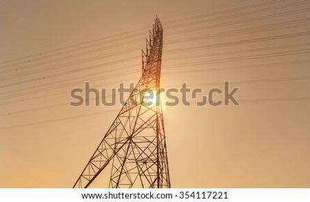 high voltage electric towers during sunset - stock photo