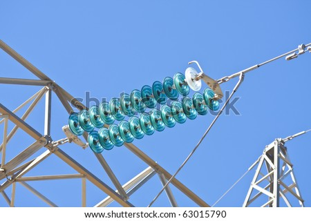 High-voltage electrical insulator electric line against the blue sky - stock photo
