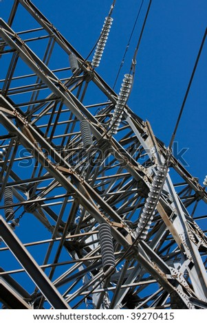 High Voltage Electrical Substation Insulators and power line - stock photo