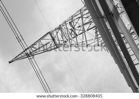 high-voltage electricity lines and pylons close up