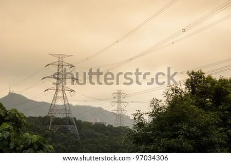 High Voltage Electricity Mast / Pylon at sunset - stock photo