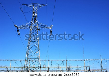 High voltage electricity pole and transformer substation - stock photo
