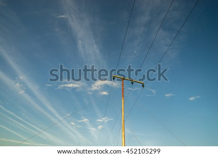 High voltage electricity pole with clear blue sky - stock photo
