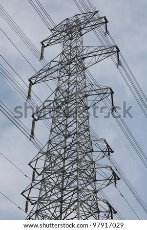 high voltage electricity pylon and the sky - stock photo